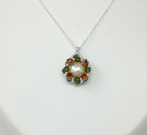 COLLIER FEMME BOULE ET STRASS ORANGE TOUPIES COULEUR PERIDOT
